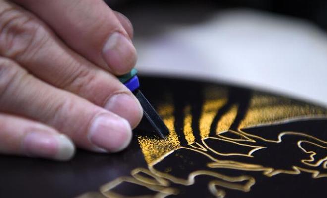 用木刻畫弘揚敦煌文化
